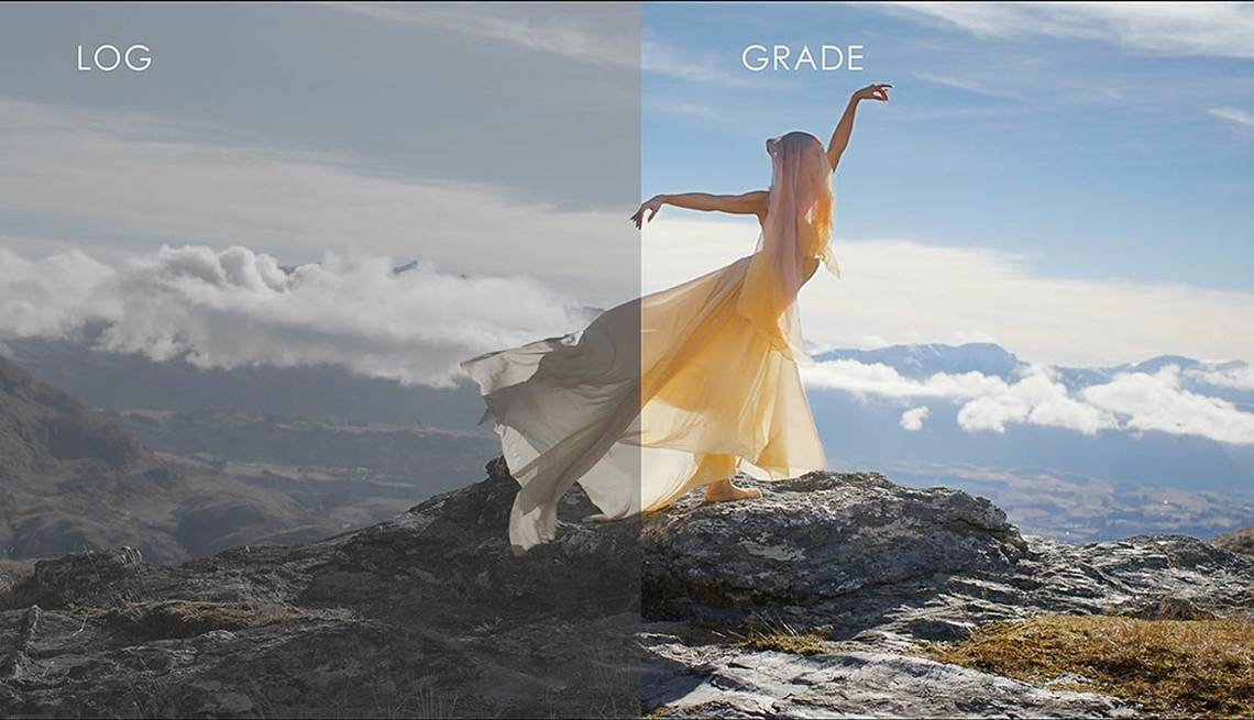 A ballet dancer in a flowing, yellow dress and shawl poses atop a mountain overlooking a valley, with half the frame showing the Canon Log version, and the other, the graded one.