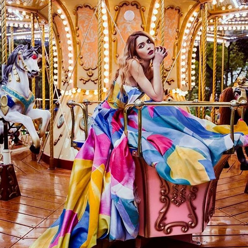 woman wearing dress on carousel