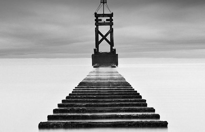 smoky black and white pier