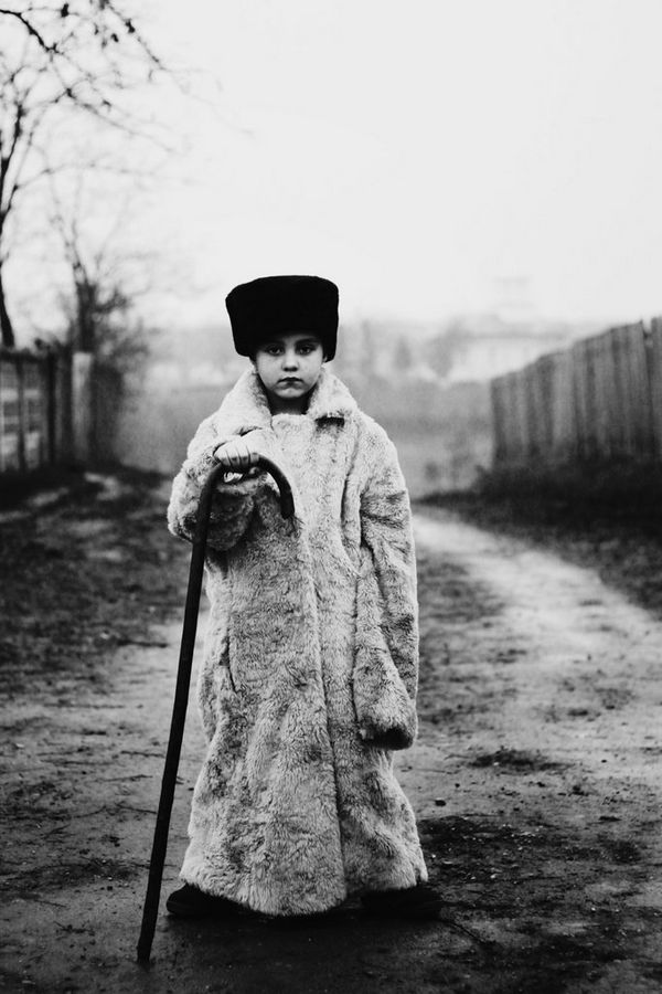 The photographer Felicia Simon's young cousin Felix dresses up and poses for her series, set in a small Romanian village.