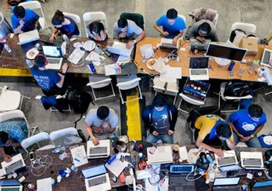 a bird's-eye view of group of people working on their laptops