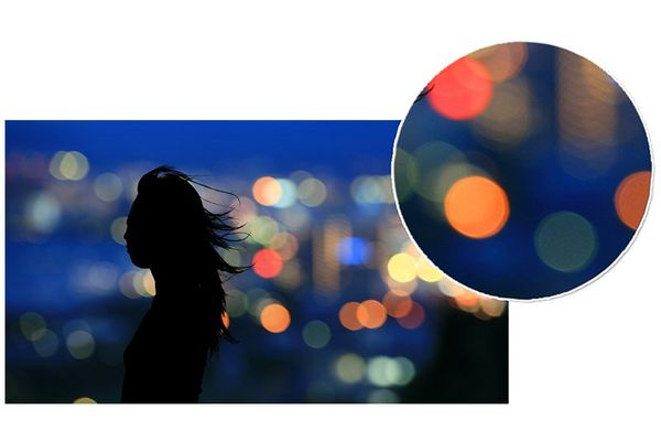 silhouette of woman in-front of city scape with zoom