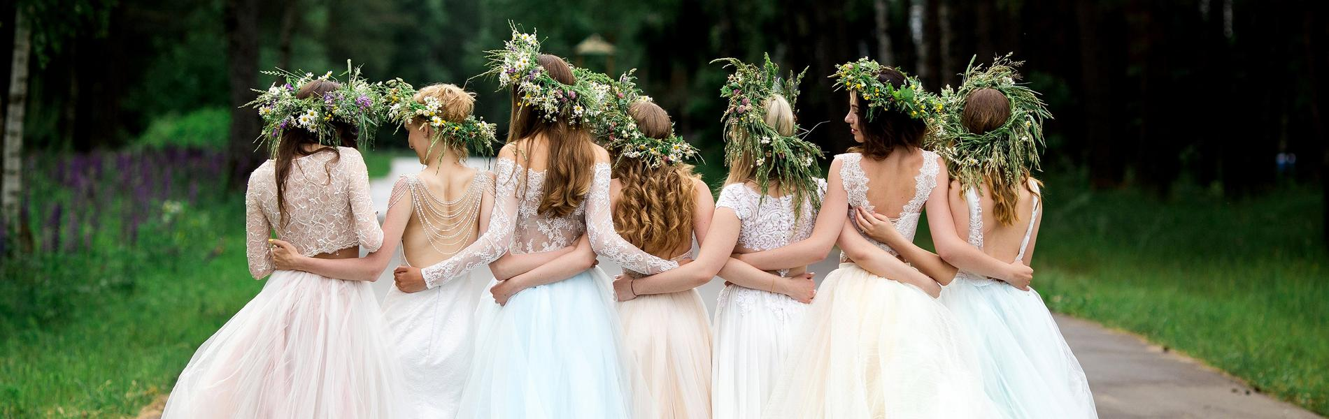 How to Beautifully Accessorise Your Wedding Gown. Group of bride and her bridesmaids locking arms