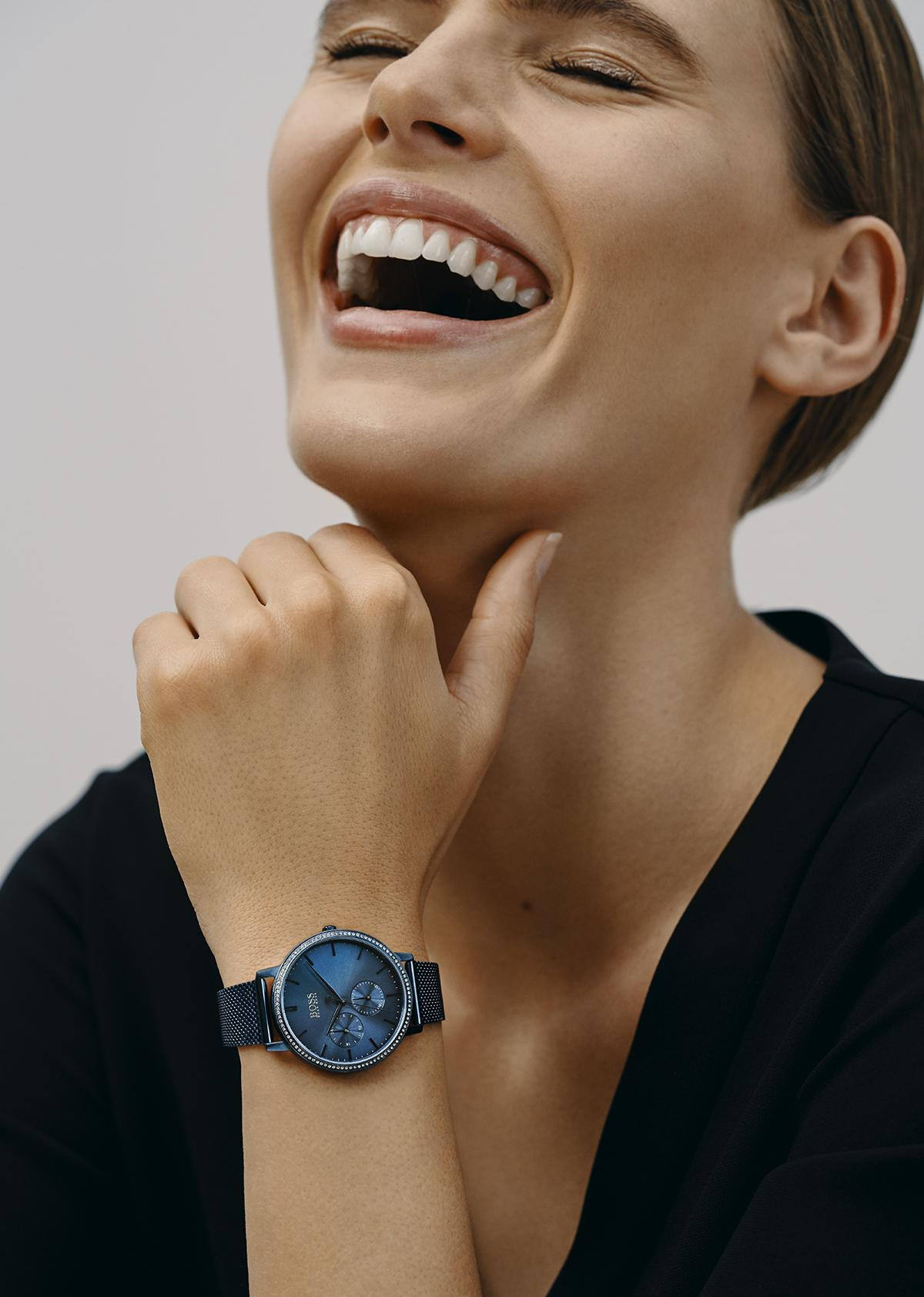 Lady smile with BOSS watch