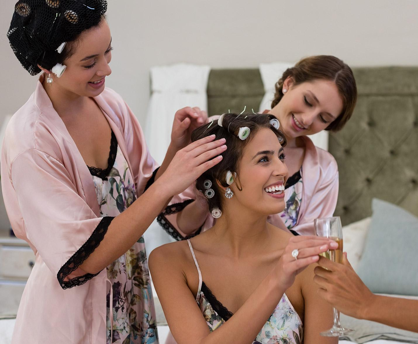Bridesmaid doing the brides hair