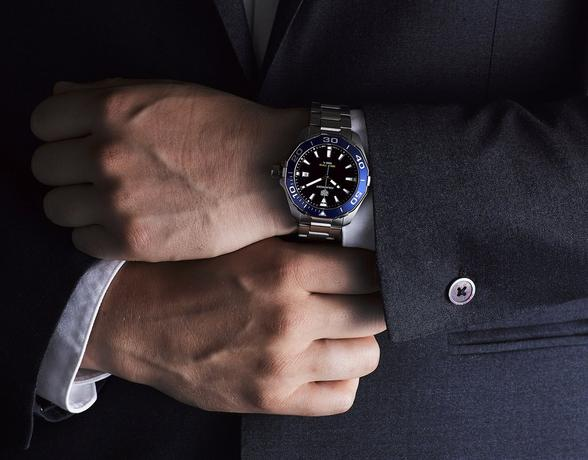TAG Heuer Watch Buying Guide 2019 - man in a suit wearing a TAG Heuer Aquaracer watch