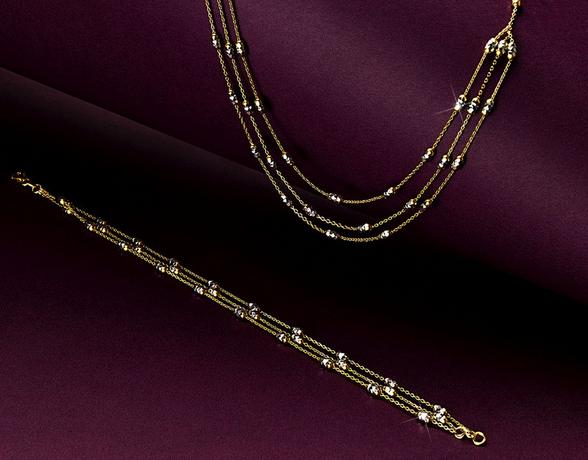 Gold necklace and matching bracelet in the Christmas  Ernest Jones Gold Collection
