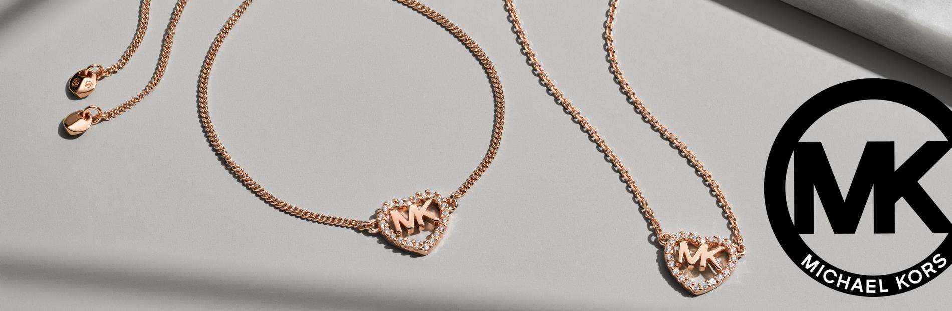 Rose Gold  Bracelet, neckless and earrings on a White background