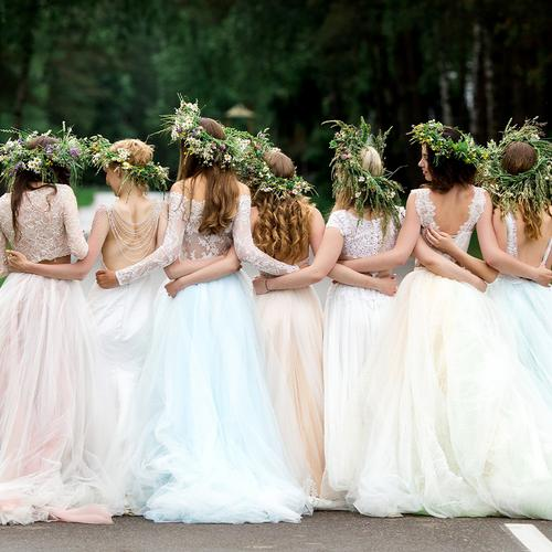 Group of bride and her bridesmaids linking arms