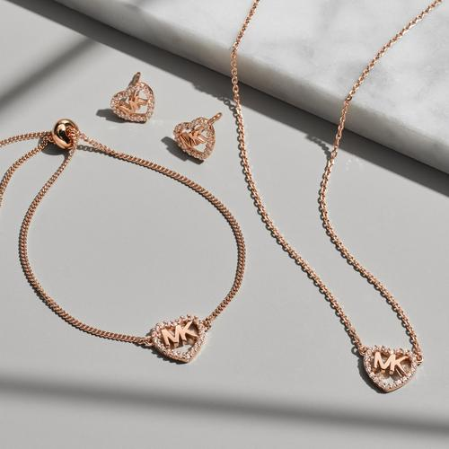 Rose Gold Jewellery set on White background