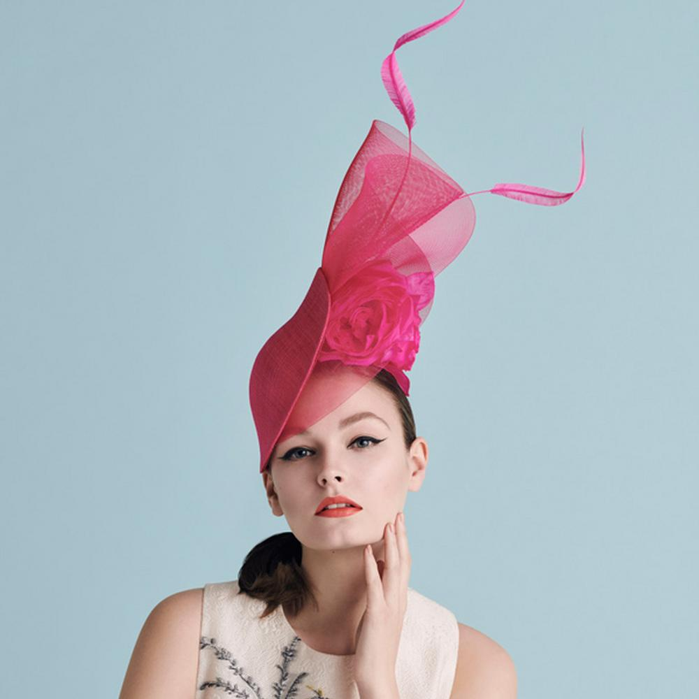 Model in a pink Philip Treacy hat