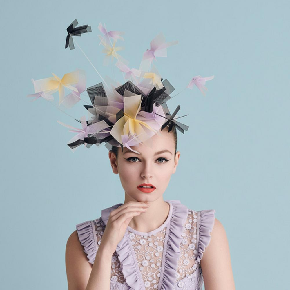 Model in a lilac and yellow Awon Golding hat