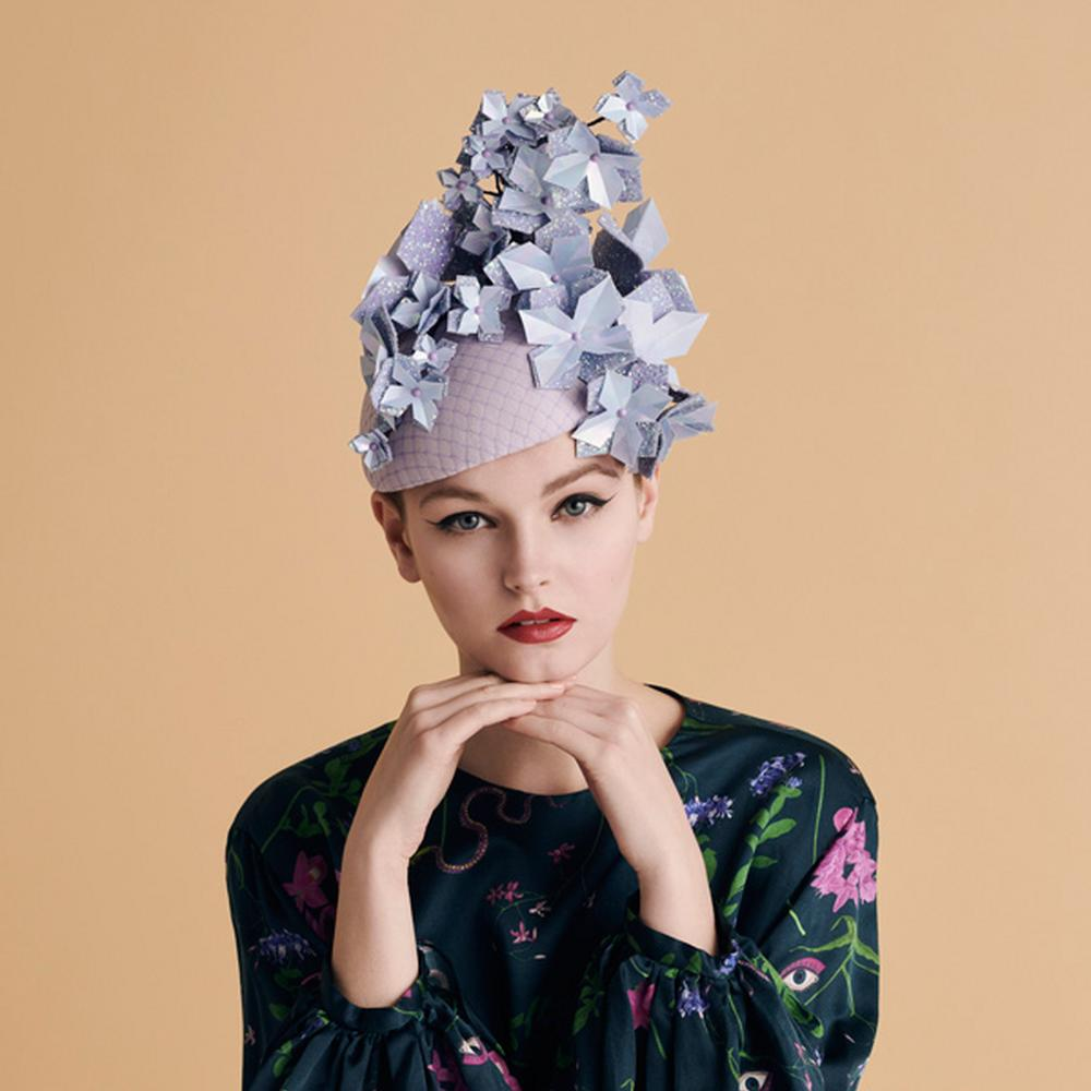 A model in a lilac Alexandra Harper hat