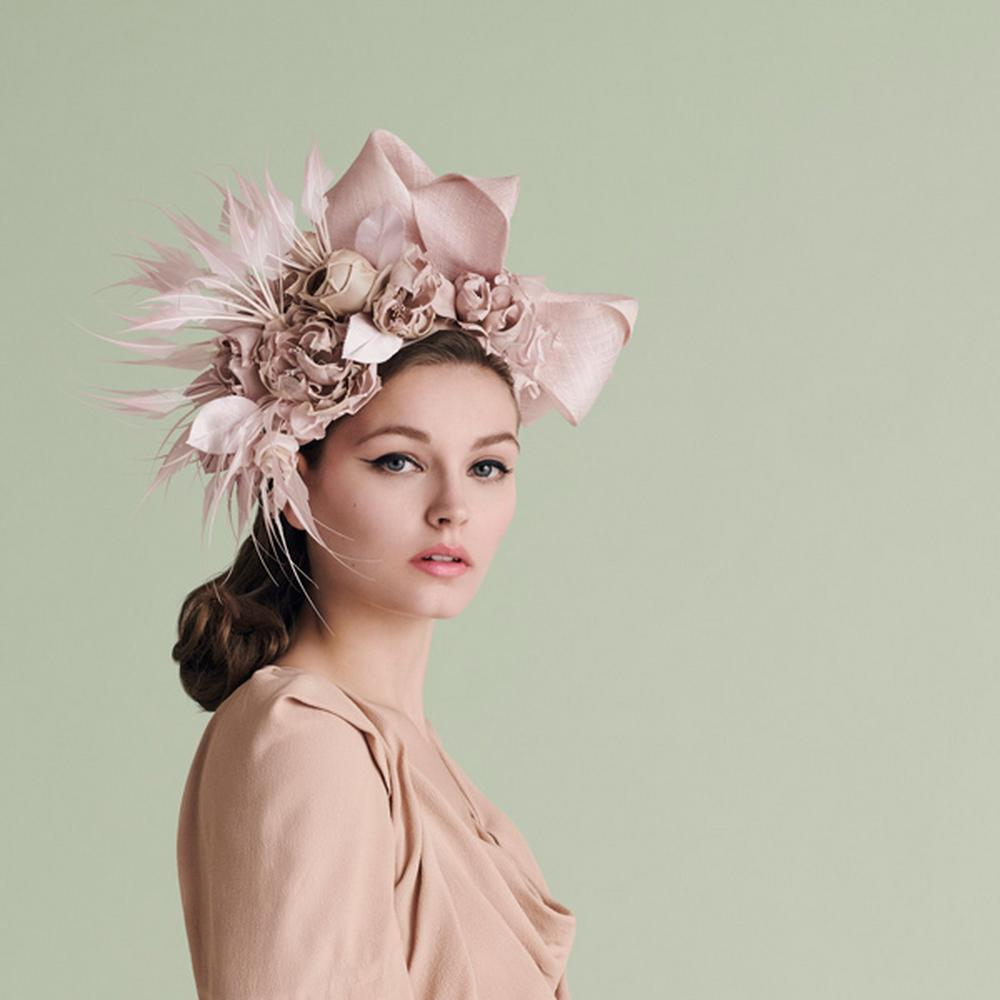 Model in a pink Rachel Trevor-Morgan hat