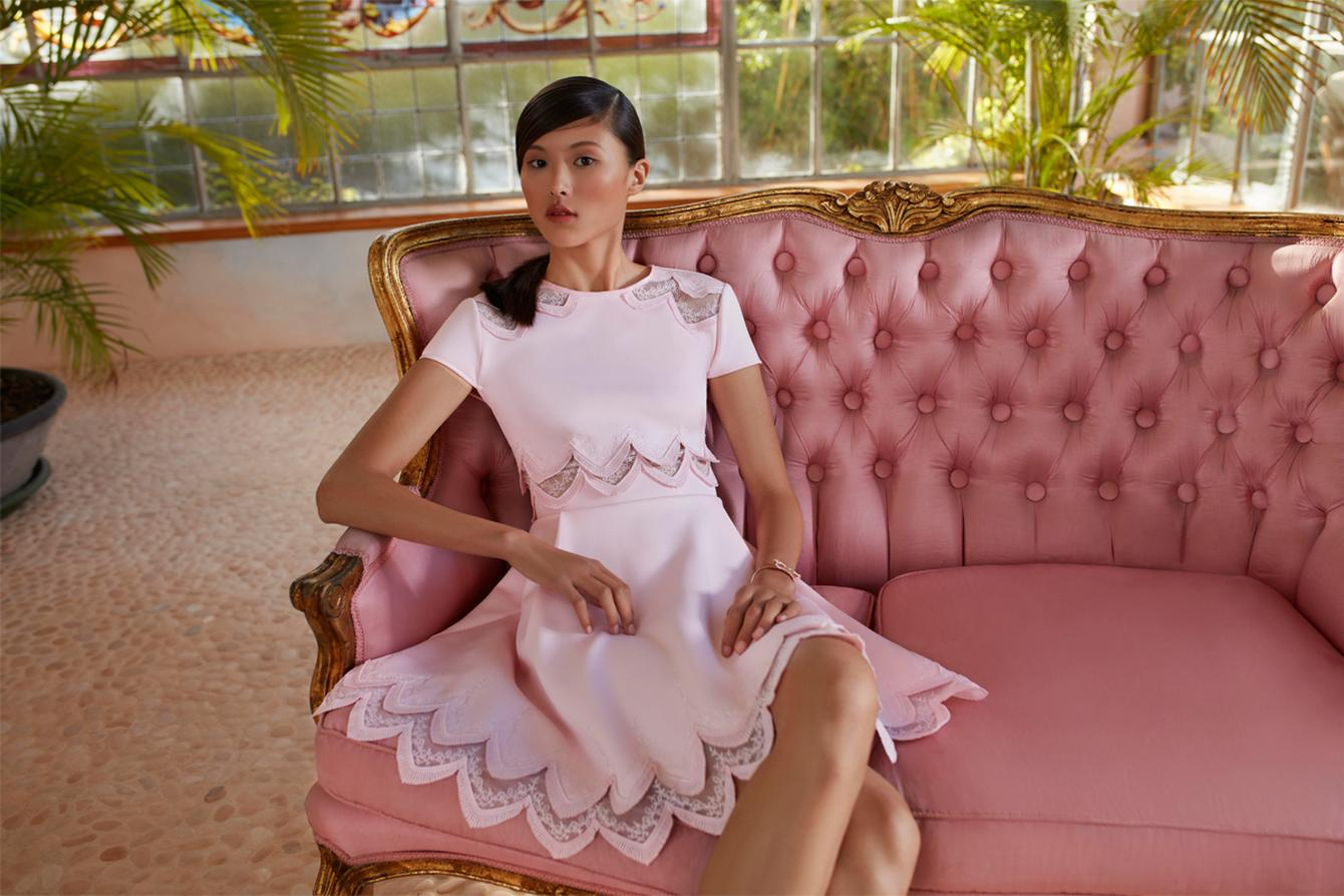 A model in a Pink Ted Baker Rehanna Dress