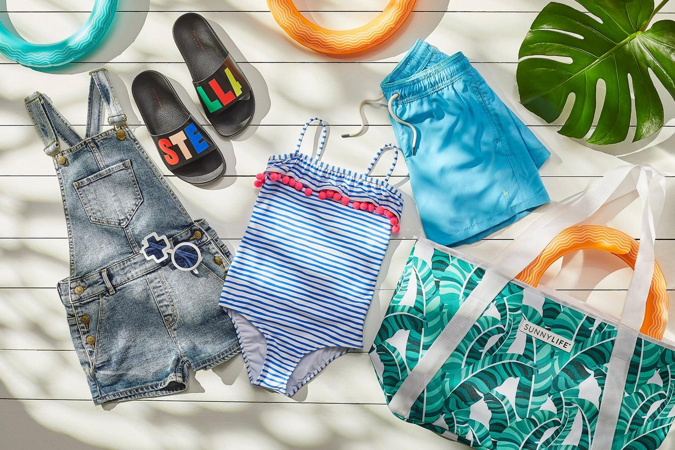 Kids swimwear, sliders & beach bag flat lay