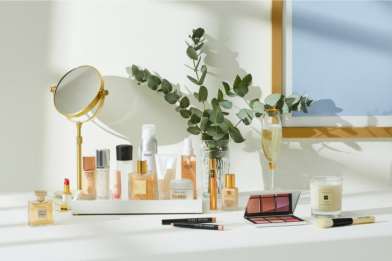 dressing table with beauty products & make-up on