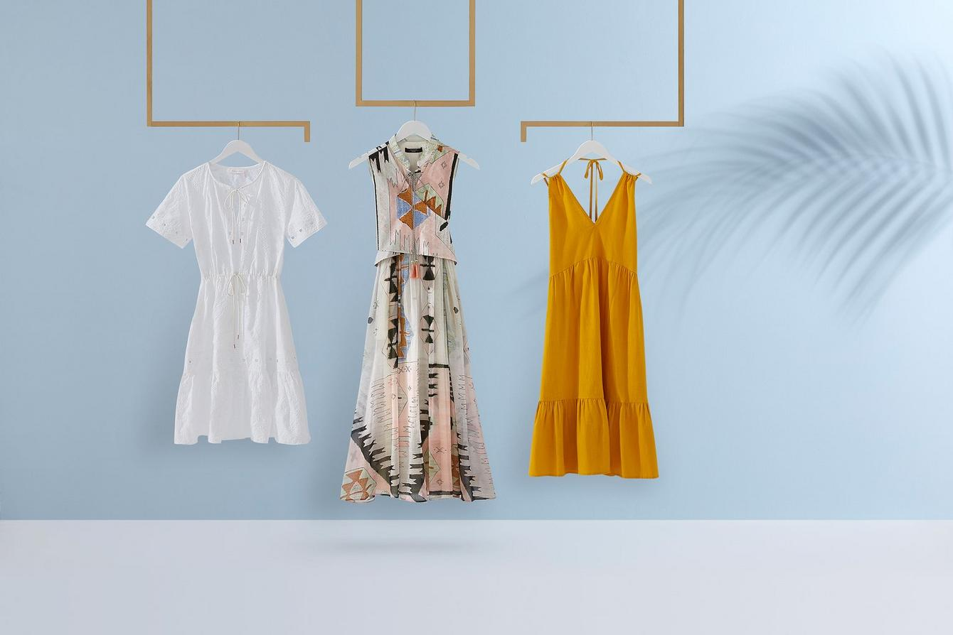 white, yellow & patterned summer dresses hanging
