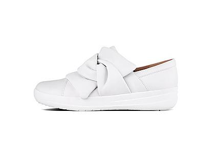 Women's slip-on white leather sneakers featuring knotted tops.