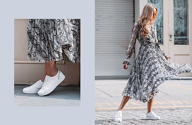 White Classic Tennis Style Shoe With Scallop Stu Details paired with a Snake-print Skirt