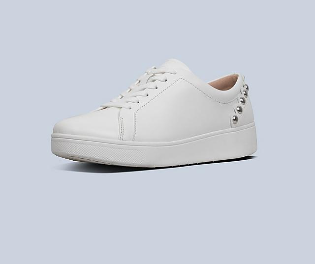 Tennis style Rally shoes in white with scallop detail and silver studs.