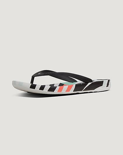 Multi-coloured mens flip-flops on a light grey background.