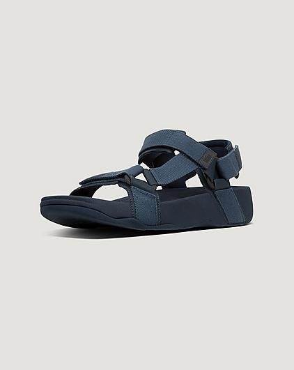 Mens navy summer sandals on a light grey background.