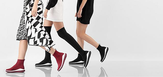 Models wearing Luxe Knit sock boots in Red and Black colour options and ankle or Knee-high styles.