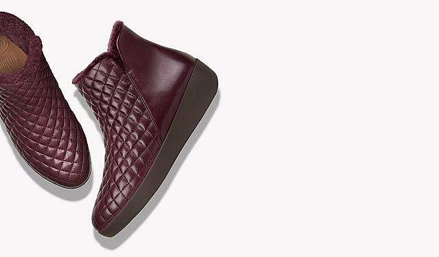 Quilted ankle boots in dark maroon on a white background.