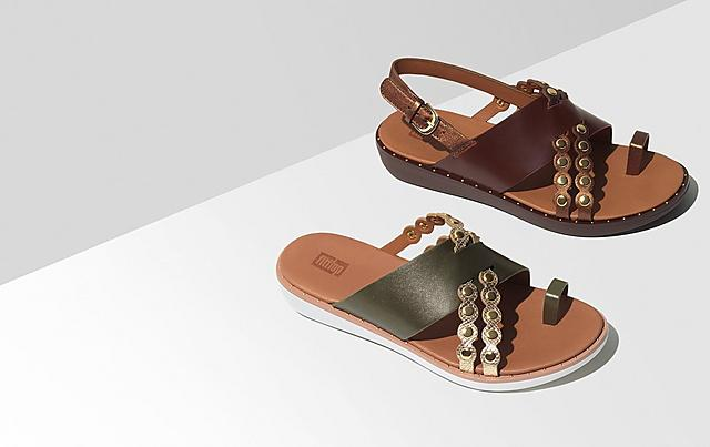 Two summer sandals, one is khaki and one is brown, placed on a light grey background.