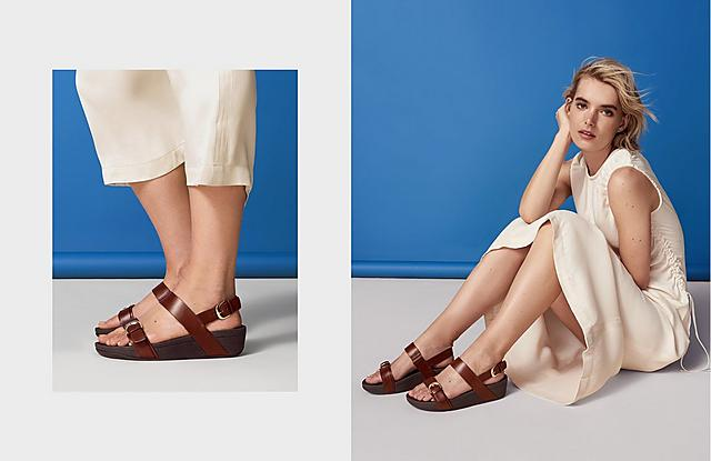 Refined leather sandals with chic gold buckles and a back-strap, shown in colour cognac.