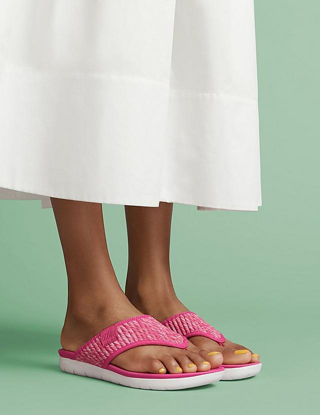 Pink Knitted flip-flops made with a soft ribbed knit fabric.