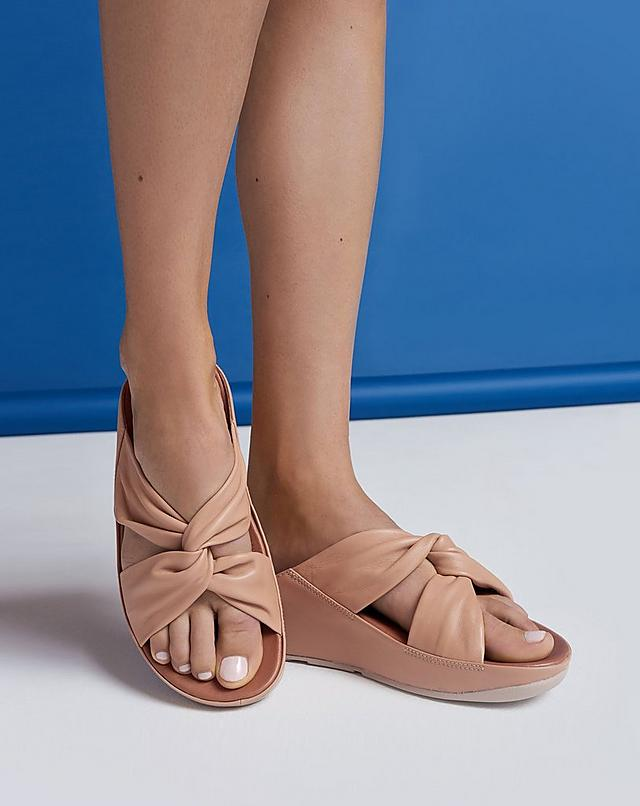 Wide leather strap sandals that intertwine and twist, shown in the colour Blush.