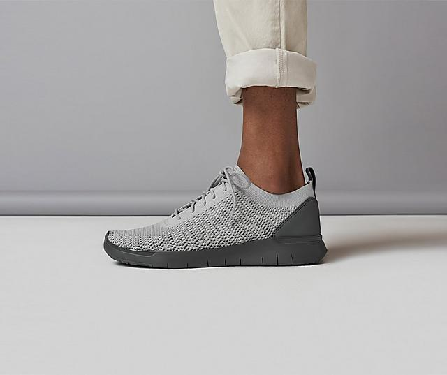Men's Knitted Light Grey Sneakers with a dark Grey base. Modelled with Beige trousers. New in the men's collection.