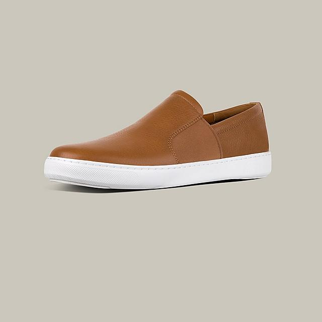 Men's Smooth  slip-on Leather shoes with elastic detailing and white base. Shown in Brown.