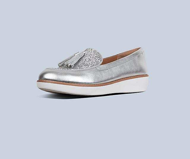 Petrina shoes in Silver on a light blue background.