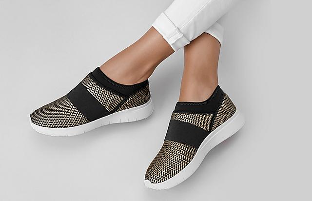 Fitflop Knitted black and gold slip-on sneakers.