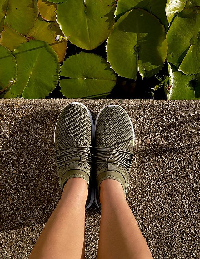 Slip-on sneakers with seamless knitted uppers made with an air-mesh fabric with Bungee laces. Shown in colour Avocado.