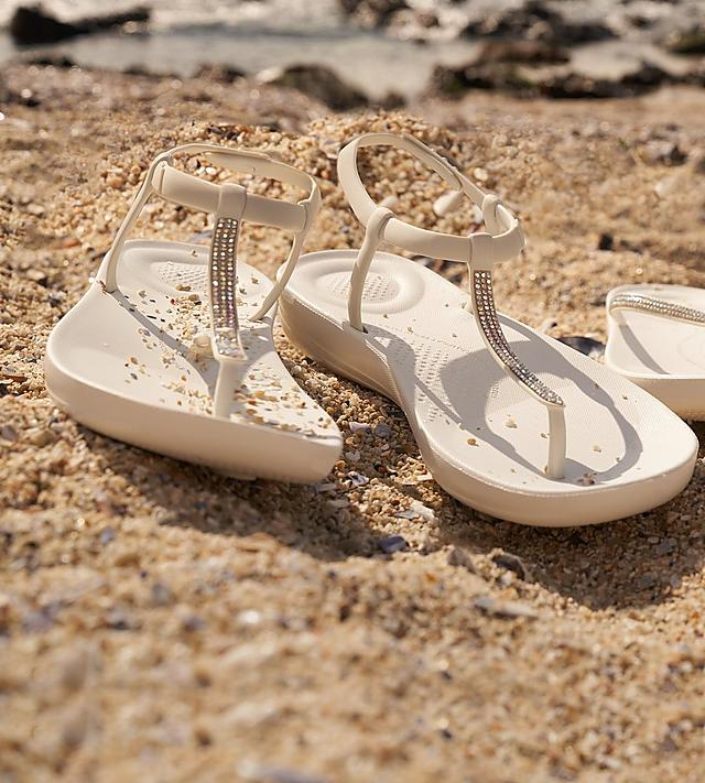 Iqushion Fitflops on Beach setting with embellished sparkles in White.