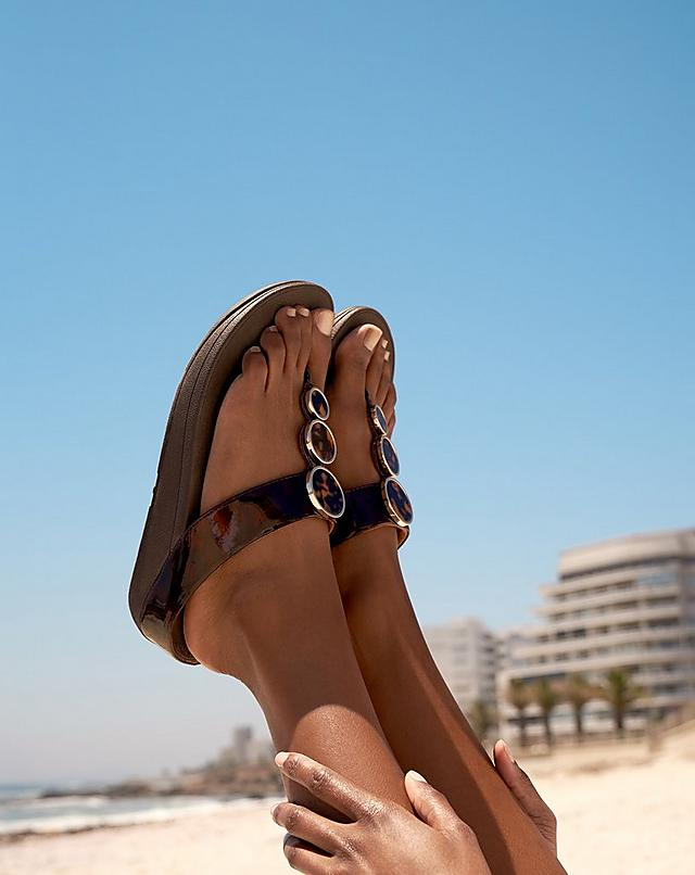 Woman wearing FitFlop Halo sandals.