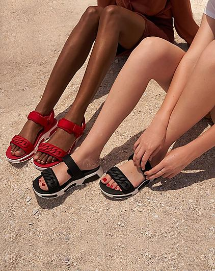 Women wearing FitFlop Heda sandals and slides.