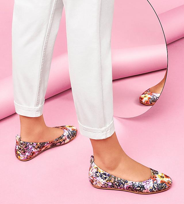 Woman wearing FitFlop Allegro Ballerina shoes in a floral print.
