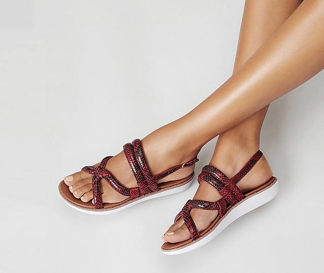 Woman wearing FitFlop Barely Sandals.