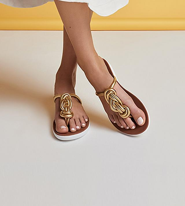 92f2efdb686b Women wearing Fitflop Barra sandals in deep brown with two classic straps  and back-straps