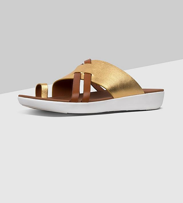 ebbbafce3 Fitflop Leather Slide Toe-thong Sandal in gold and tan colours.