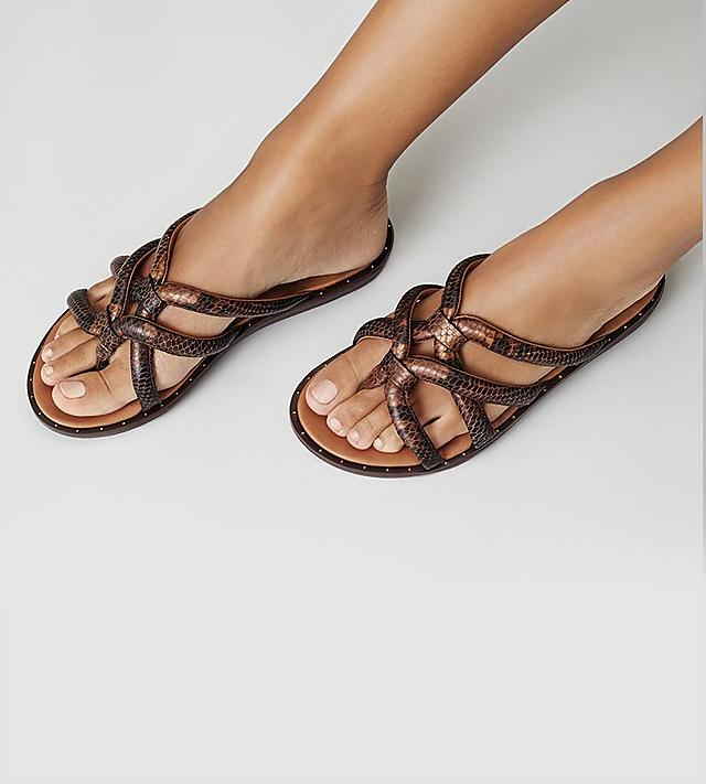 Fitflop Barely sandals sold online only, Slip-on toe-thong sandals with snake-print patterned detail.