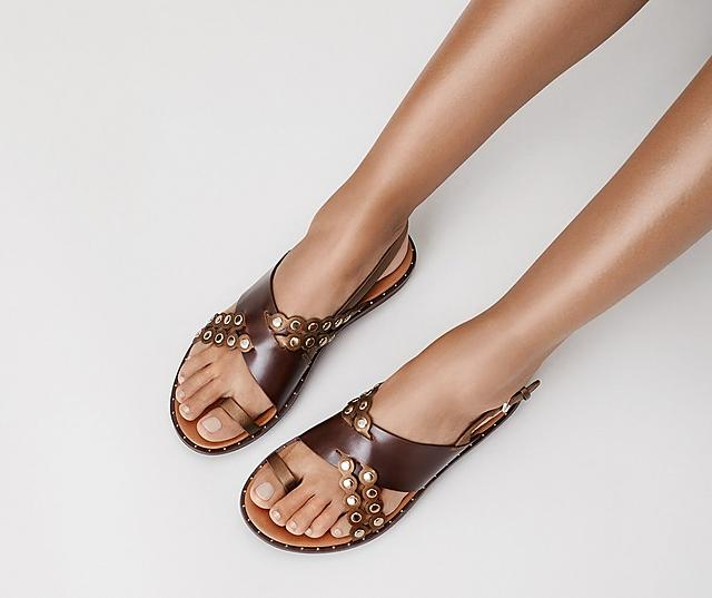 Fitflop Scallop sandals in brown and gold with leather embellished straps