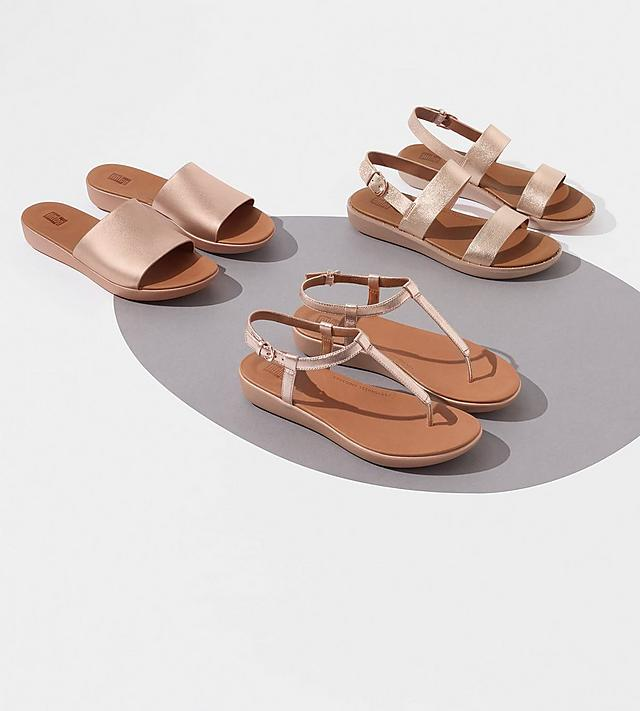 Fitflop leather sandals in rose gold. Choose from slides, toe-thongs and back-strap sandals.