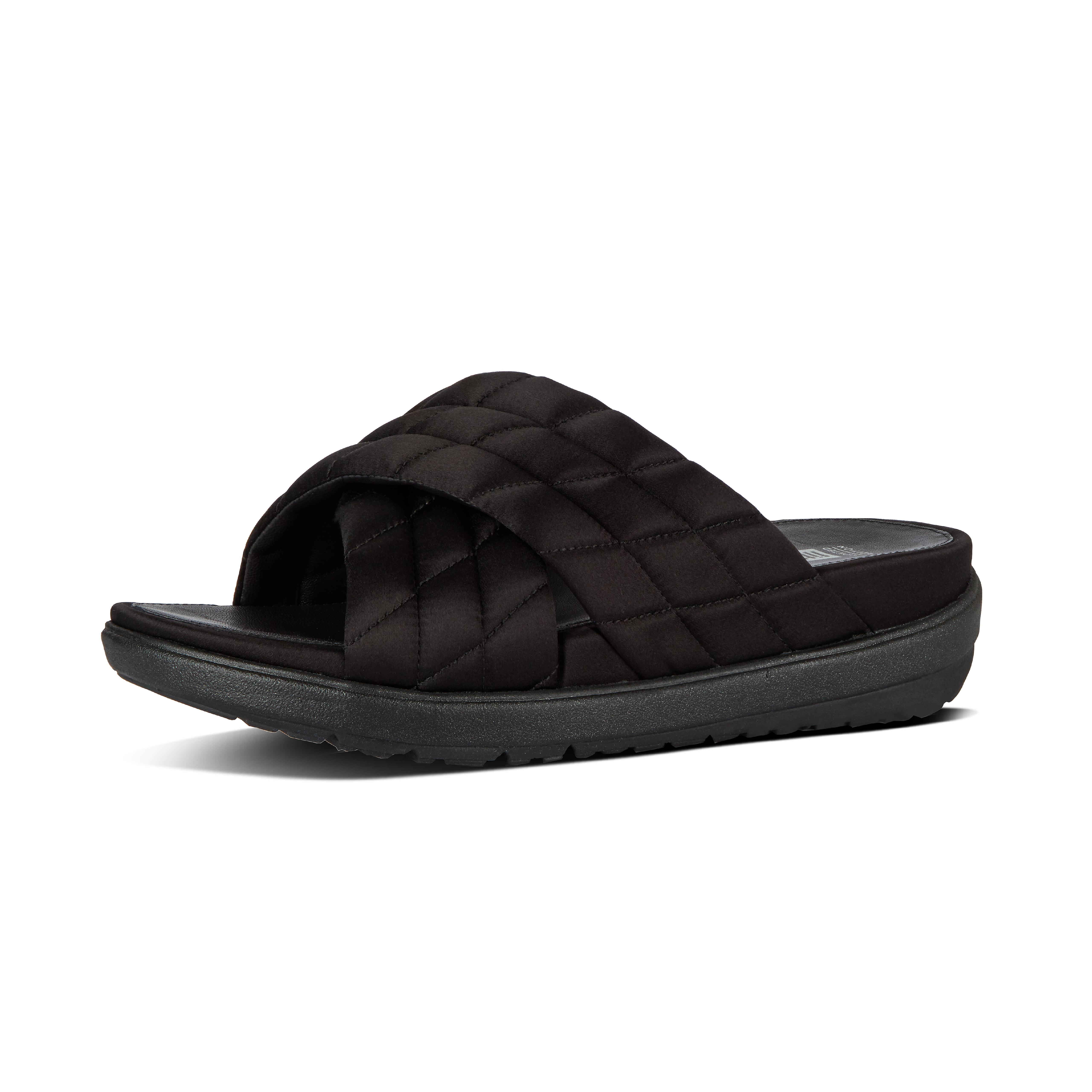 """Slides to Loosh your head over. Our fabulously fashionable cross slides step out in a super de luxe, limited-edition version. Think silky satin uppers, cushiony quilting that hugs your feet (and earns serious style points), full-leather linings and a generous helping of sports-casual cool. All on our out-of-this-world-comfortable Microwobbleboard midsoles. Repeat after us: """"My feet are worth it."""""""
