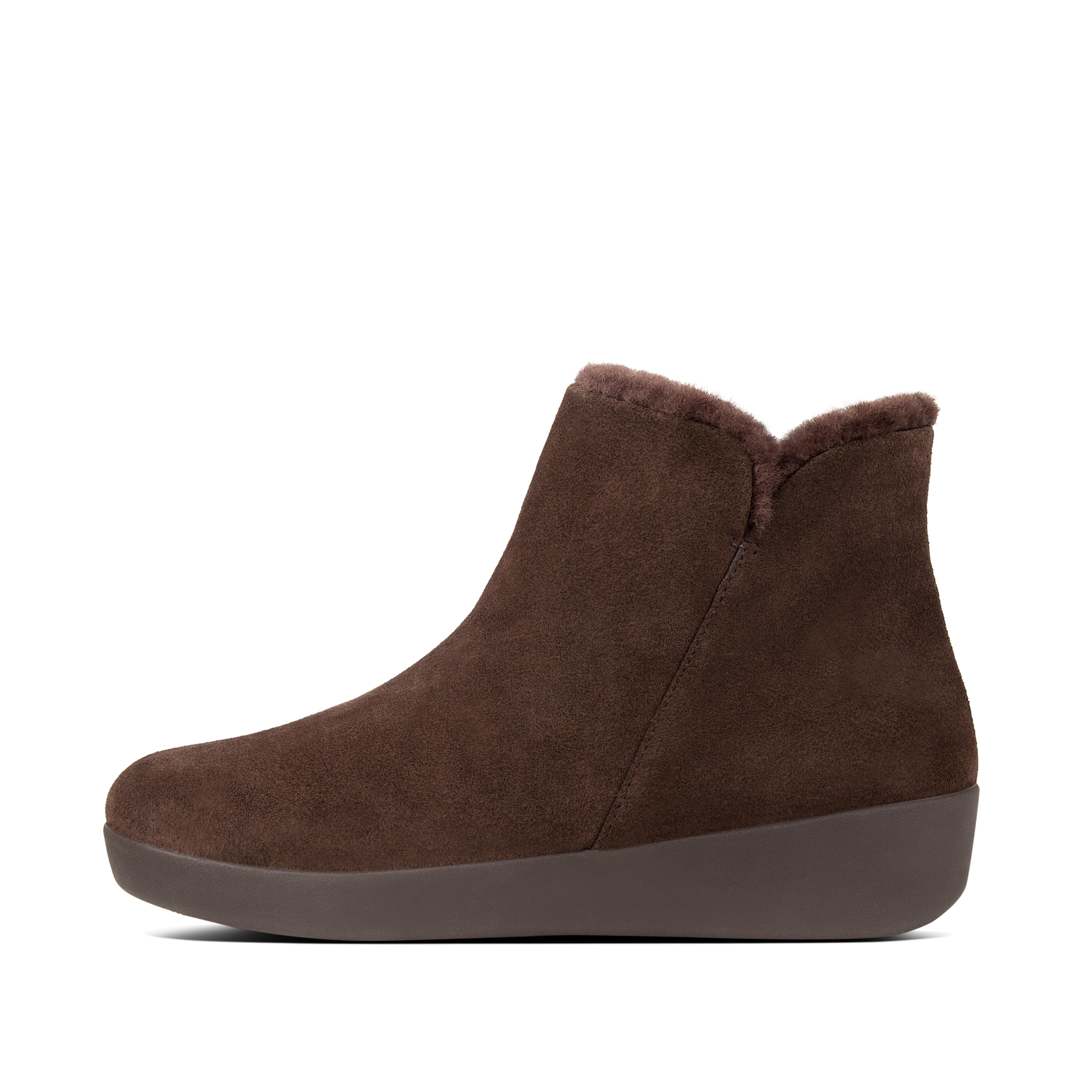 Proof that superchic can be really cosy. These sleek little zip-up ankle boots, here in suede, are lined in soft, fluffy, toasty shearling, with our Supercom FF midsoles underneath, for amazing all-day comfort and cushioning. They're versatile too - try them with a shift dress, skinny jeans or a trouser suit.